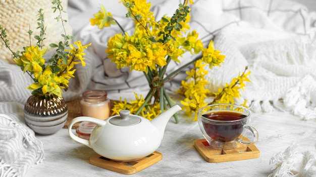 Spring still life with a cup of tea and flower Free Photo