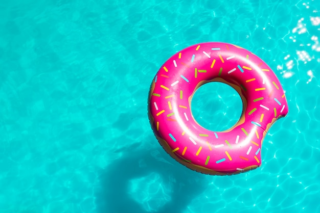 Sprinkled inflatable toy in pool bright water Free Photo