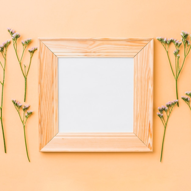 Square frame near small flowers Photo | Free Download