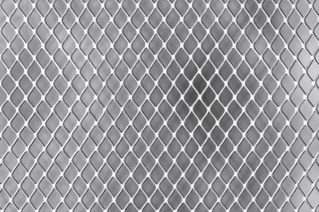 Square grid on white wall metal close-up Premium Photo