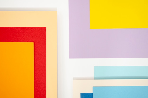 Squares of abstract composition with colour papers Free Photo