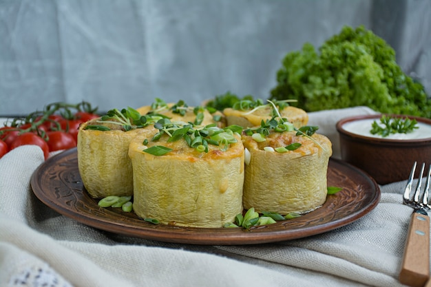 Squash stuffed with minced meat, vegetables and sprinkled with hard cheese. side view. Premium Photo