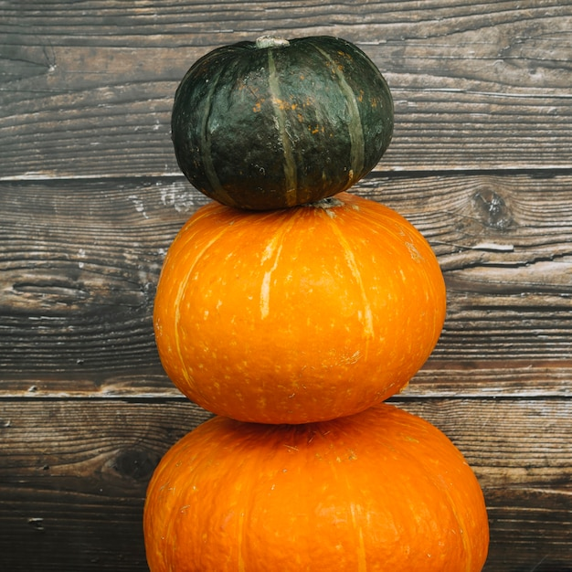 Squashes near wooden wall Free Photo