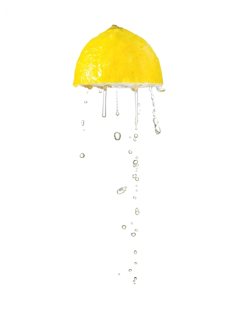 Squeeze lemon isolated on white Premium Photo