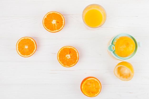 Squeezing juice from citrus fruit Free Photo