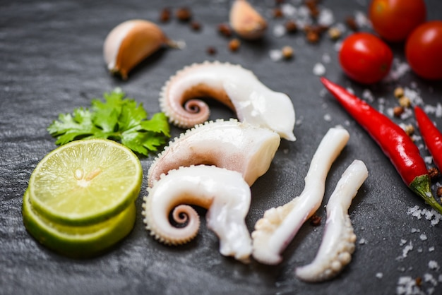 Squid salad with lemon herbs and spices tentacles octopus cooked appetizer food Premium Photo