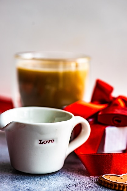 St. valentine day concept with coffee cup and cookies Premium Photo