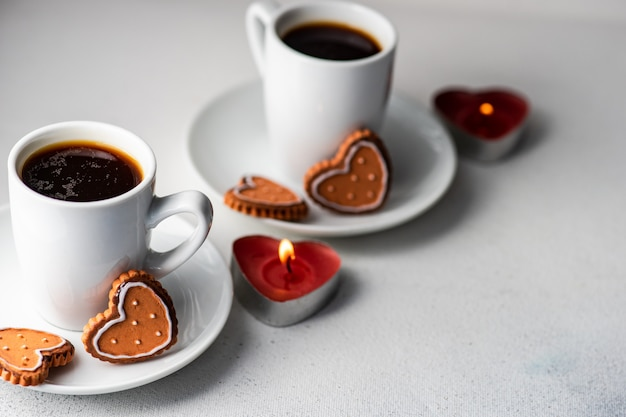 St. valentine day concept with coffees and cookies Premium Photo