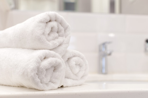 Stack of bath towels on light background Premium Photo