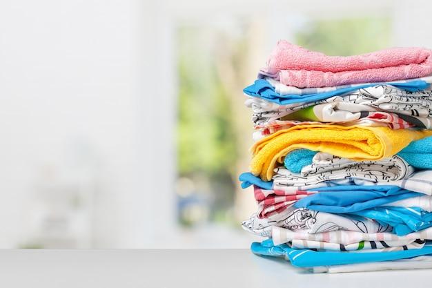 Stack of bath towels on light white background closeup Premium Photo