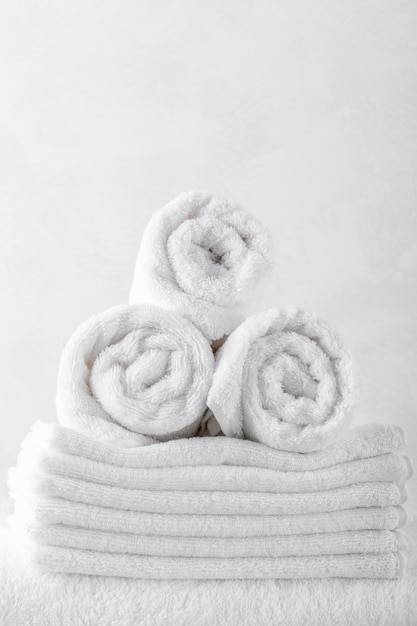 Stack of bath towels on wooden table Premium Photo