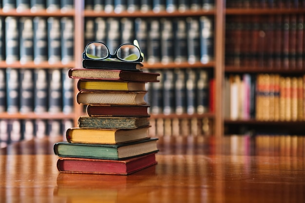 Stack of books and glasses in library Free Photo