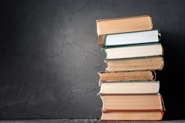 Stack of books on the table Premium Photo