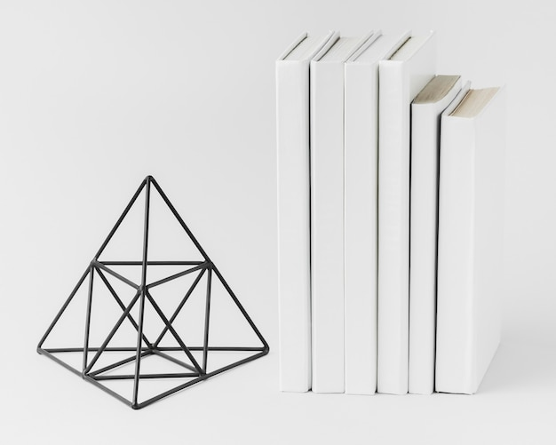 Stack of books with 3d ornament Free Photo