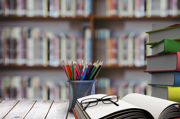 Stack of books with glasses on wooden desk Free Photo