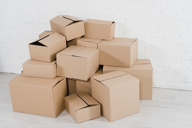 Stack of cardboard boxes in the empty room Free Photo