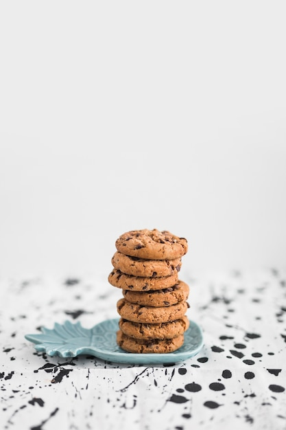 Stack of chocolate chip cookies on pineapple shaped plate Free Photo