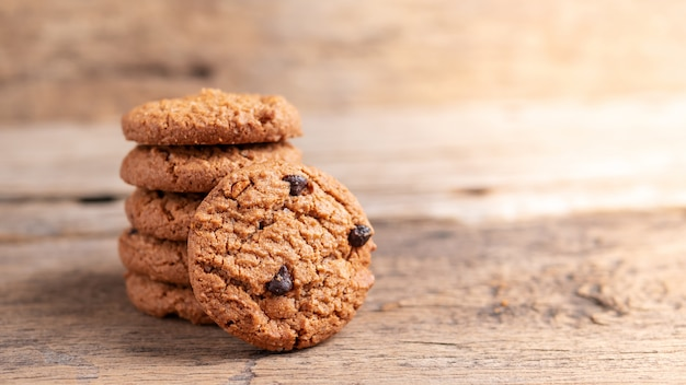 Stack of chocolate chip cookies on wooden table Premium Photo