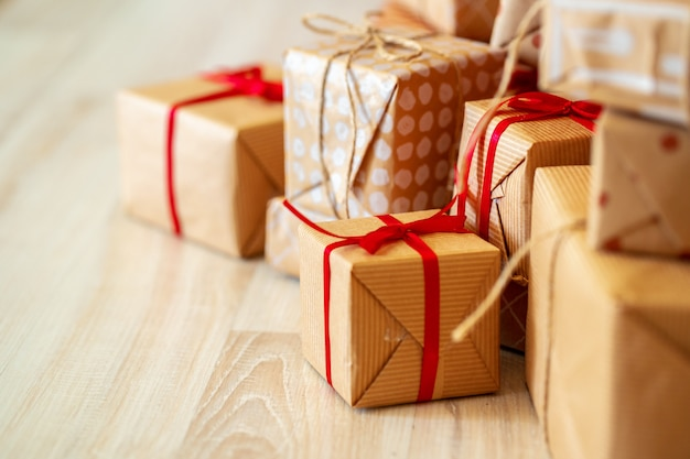 Stack of christmas gifts on beige carpet Premium Photo