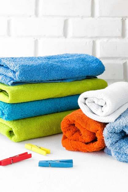 Stack of clean soft towels on white background Premium Photo