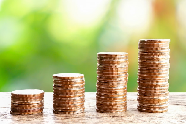Stack of coins over nature background Premium Photo