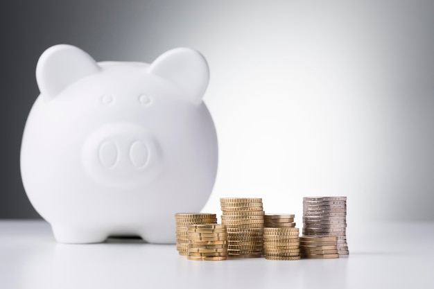 Stack of coins and piggy bank Premium Photo