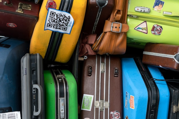 Stack of colorful travel suitcases at terminal airport Premium Photo