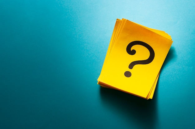 Stack of colorful yellow cards with question mark Premium Photo