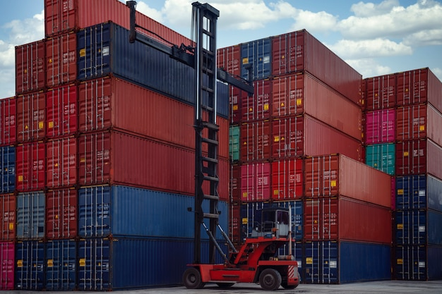 Stack of container box in transportation port with container lift car, this image can use for shipping, container, delivery and business concept Premium Photo