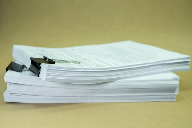 Stack documents on cardboard brown paper in concept save earth Premium Photo