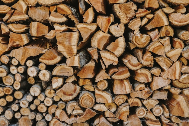 Stack of firewood textured background Free Photo