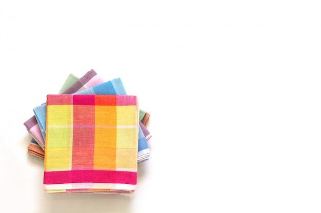 Stack of folded handkerchiefs on white background, copy space Premium Photo