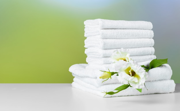 Stack of folded white spa towels Premium Photo