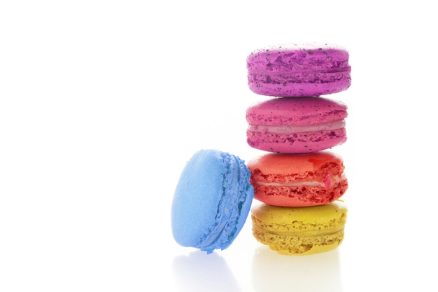 Stack of french macarons on white background Premium Photo