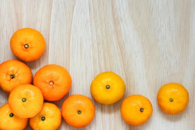 Stack of fresh mandarin oranges on wood Premium Photo