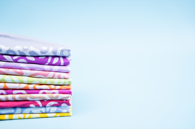 Stack handkerchief on blue background. Premium Photo