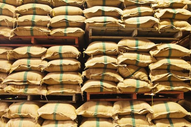 Stack hemp sacks of rice Premium Photo