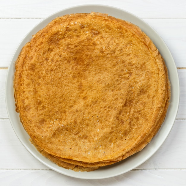 Stack of kefir buttermilk pancakes traditional for russian pancake week top view Premium Photo