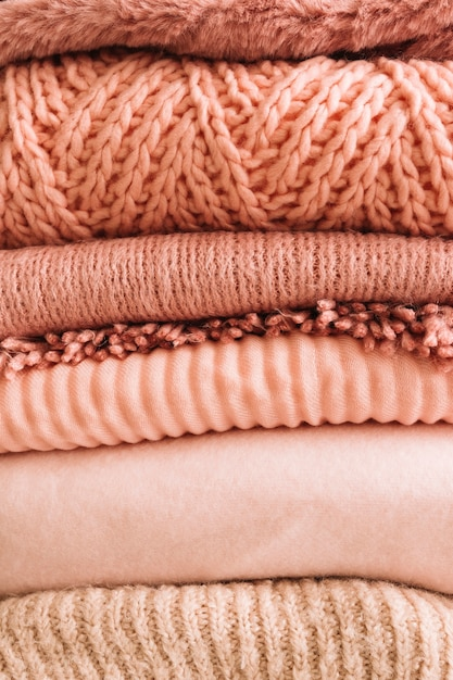 Stack of knitted sweaters Free Photo