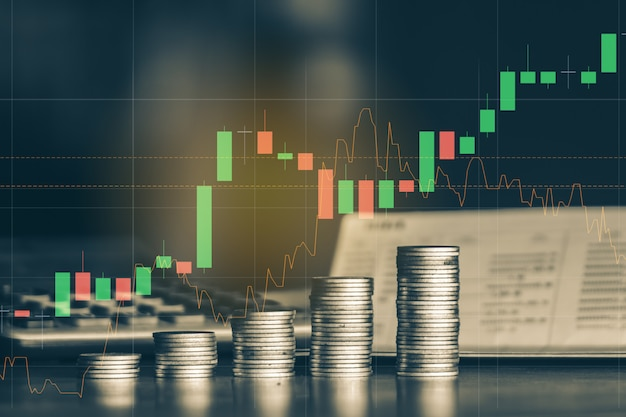 Stack of money coin with trading graph, financial investment background Premium Photo