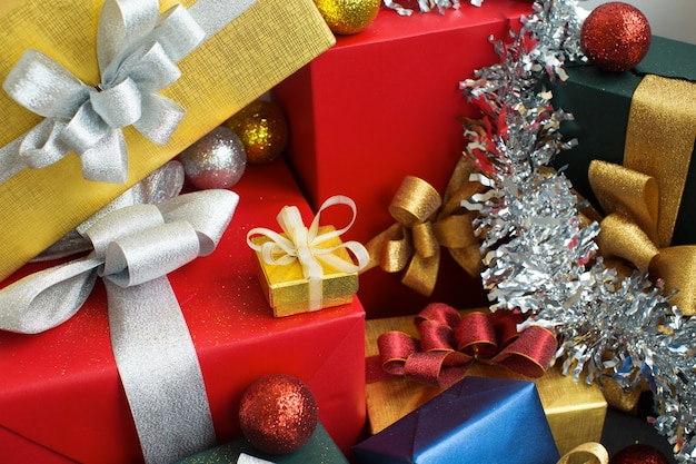 stack of beautiful christmas gifts and decorations premium photo - Christmas Gift Decorations