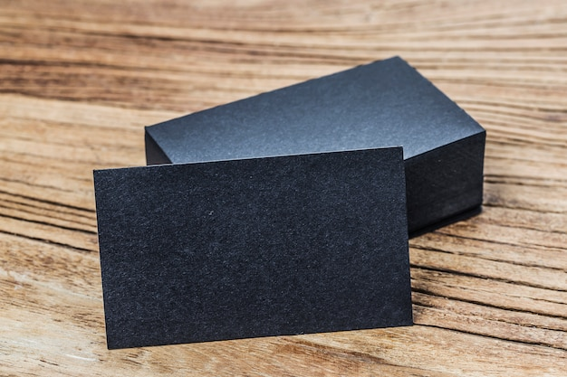 stack of blank black business cards on wooden background photo