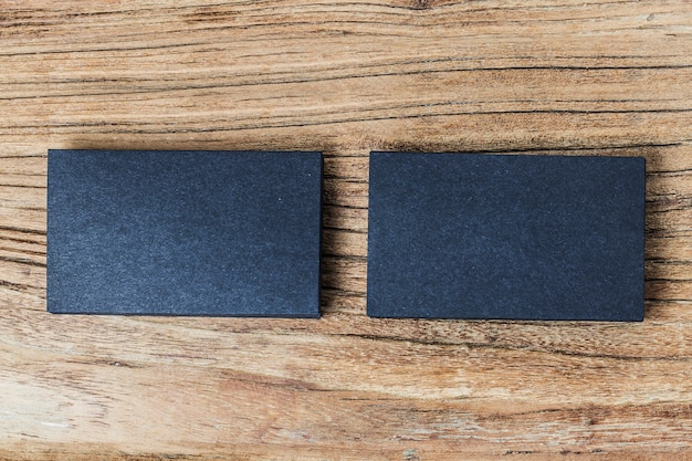 Stack of blank black business cards on wooden background photo stack of blank black business cards on wooden background free photo reheart Gallery
