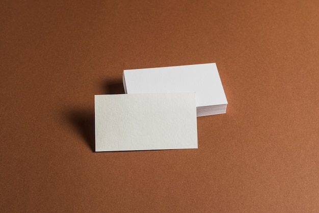 Stack of blank business cards on brown background photo free download stack of blank business cards on brown background free photo reheart Gallery