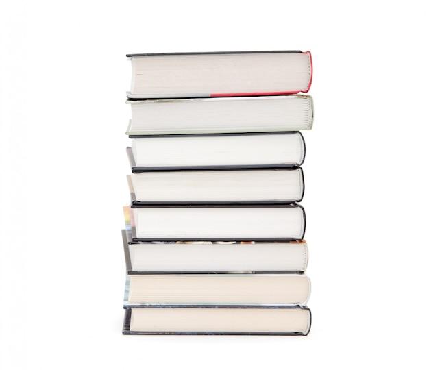 白い背景で隔離の書籍のスタック Premium写真