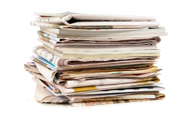 Stack of old newspapers and magazines  Free Photo