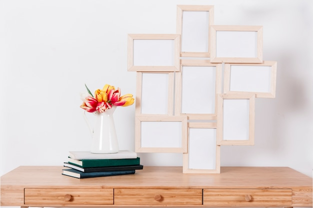 Stack of photo frames in interior Free Photo