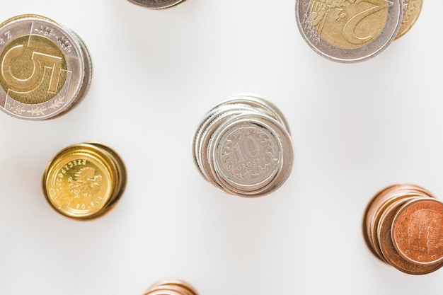 Gold And Copper : Stack of silver gold and copper coins stack on white background
