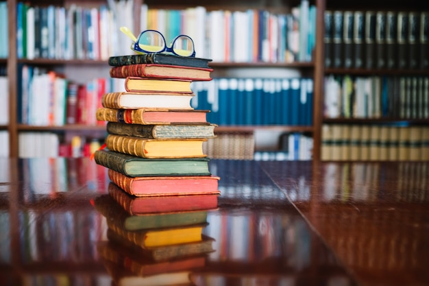 Stack of old books in library Free Photo