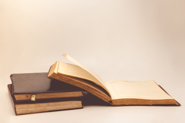 A stack of old books with vintage background. Premium Photo